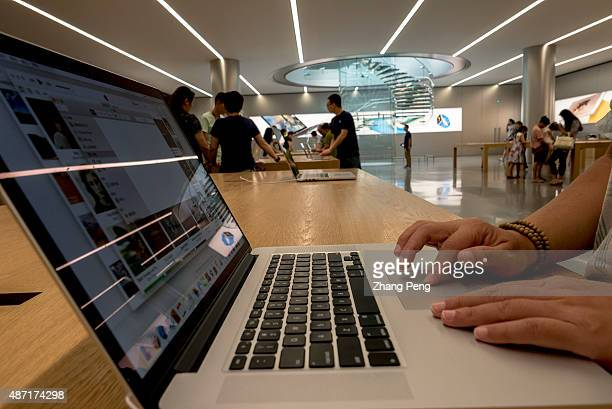 Chinese customer is trying a Macbook product in an Apple store in Chongqing Apple has experienced strong growth for the business in China through...
