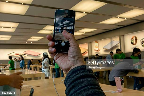 Chinese customer is trying out an iPhone SE in an Apple store located on Huaihai road In China Apple booked 34 million preorders for the iPhone SE...