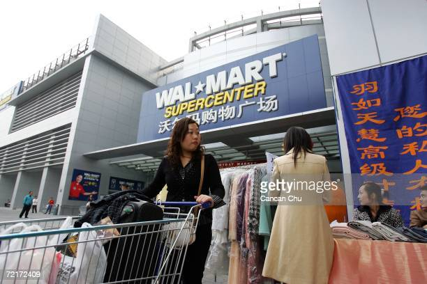 Chinese customer leaves after shopping at Beijing's first WalMart supercenter October 14 2006 in Beijing China WalMart workers in China have set up...