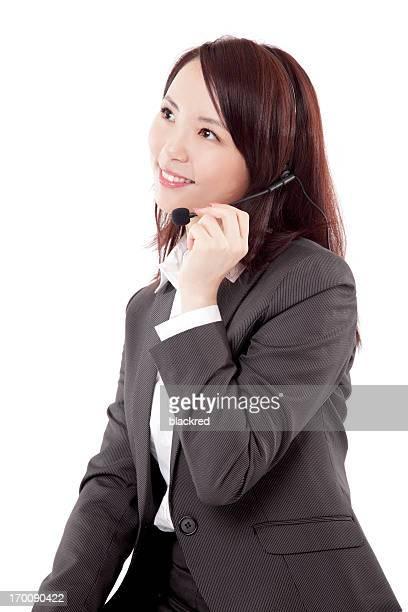 中国の顧客サービス担当者に、ヘッドセット笑顔に白背景