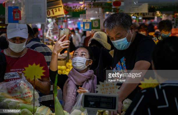 Chinese customer uses her mobile to scan a QR code while paying with the WeChat app at a local market on September 19, 2020 in Beijing, China. The...