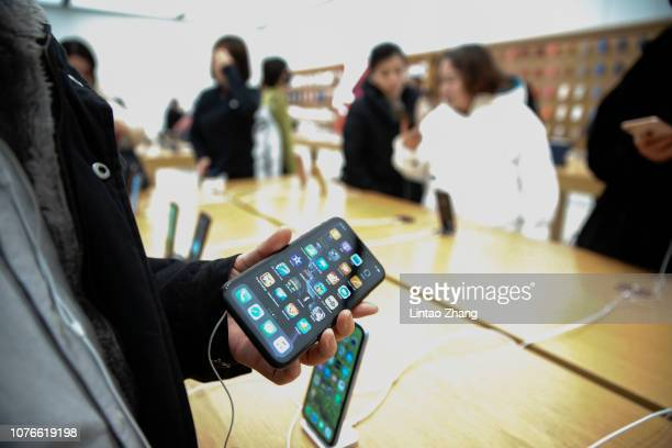 Chinese customers are seen experiencing and choosing Apple's products in an Apple store on January 3 2019 in Beijing China Apple Inc lowered its...