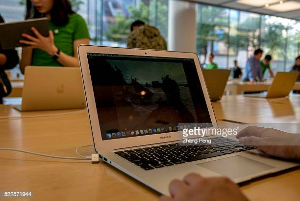Chinese customers are trying out Macbooks in an Apple store located on Huaihai road Apple had 28 stores in China through the end of 2015 but it plans...
