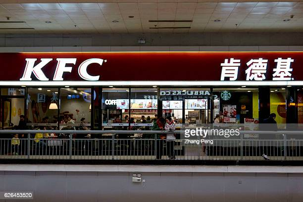 Chinese customers have dinner in a KFC restaurant in Beijing West railway station As the largest restaurant chain in China with more than 7000...