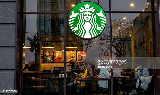 Chinese customers in a Starbucks coffee house Starbucks already has nearly 2000 stores in mainland China and plans to have 3400 by 2019 laying the...