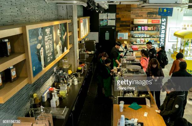 Chinese customers in Starbuck coffee shop In 2017 the revenue of Starbucks China rose by 30% and till 2021 the total amount of Starbucks coffee shops...