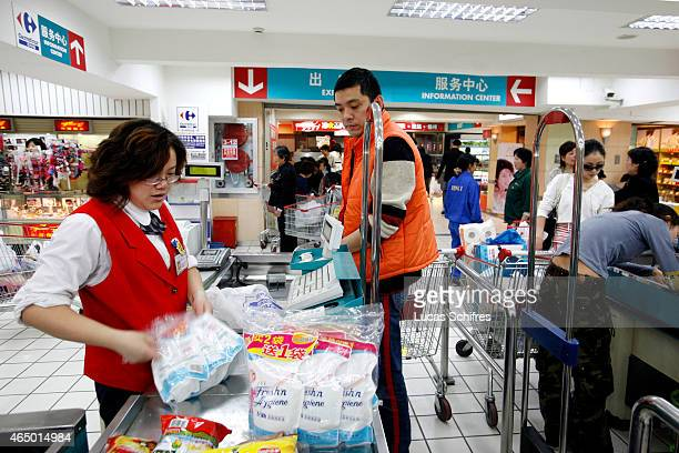 Chinese customers pay for their purchases at Wuning supermarket on April 17 2008 in Shanghai China