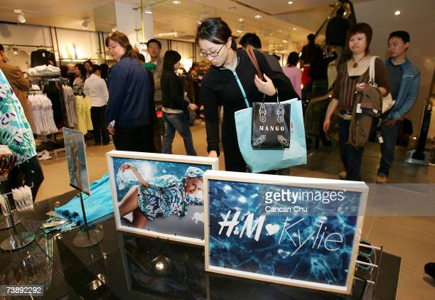 """Chinese customers shop the just launched limited edition """"H&M Loves Kylie"""" dresses at the newly opened Swedish giant H&M's first mainland China store..."""