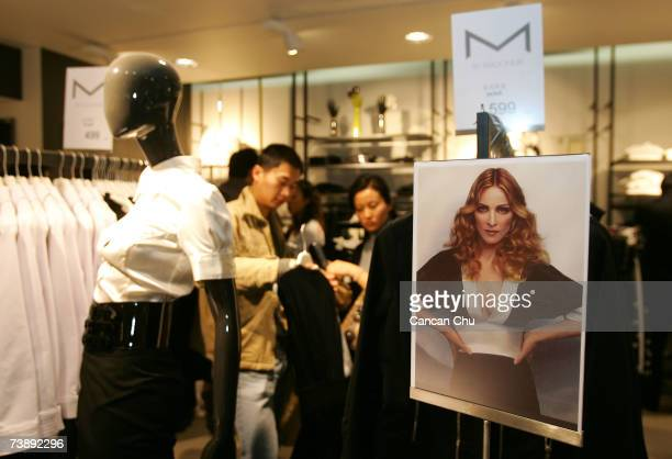 Chinese customers shop the M collection designed by Madonna at the newly opened Swedish giant H&M's first mainland China store on April 15, 2007 in...