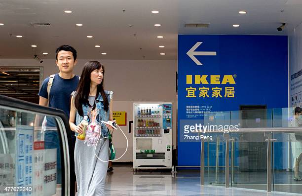 Chinese customers walk out of IKEA Beijing Xihongmen Store IKEA Beijing Xihongmen Store located in a large shopping center named LIVAT developed by...