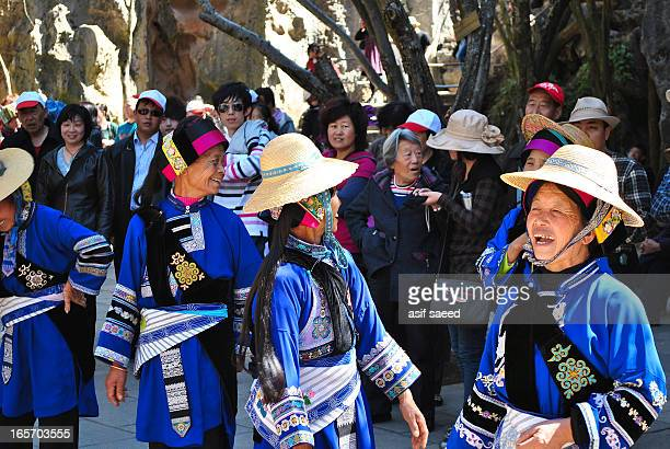 Chinese Dancers oerforming in traditional costumes in Stone Forest Area of Kunming City, Yunnan Province China