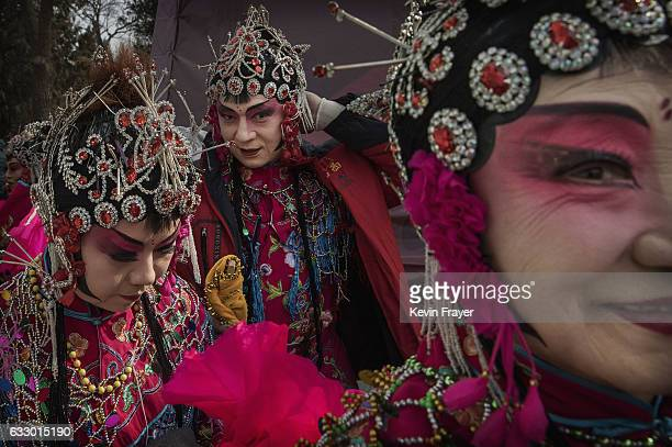 Chinese dancers wear costumes after performing at a fair on the second day of the Chinese Lunar New Year on January 29 2017 in Beijing China China is...