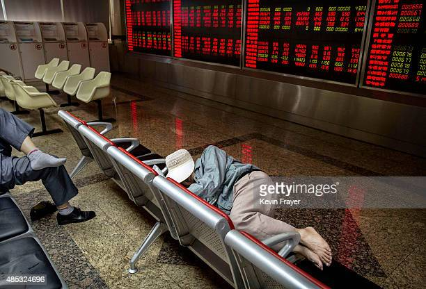 Chinese day trader rests at a local brokerage house on August 27 2015 in Beijing China A dramatic selloff in Chinese stocks caused turmoil in markets...