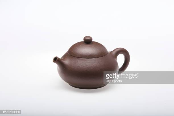 chinese deep brown teapot isolated on white background; studio shot. - brown stock pictures, royalty-free photos & images