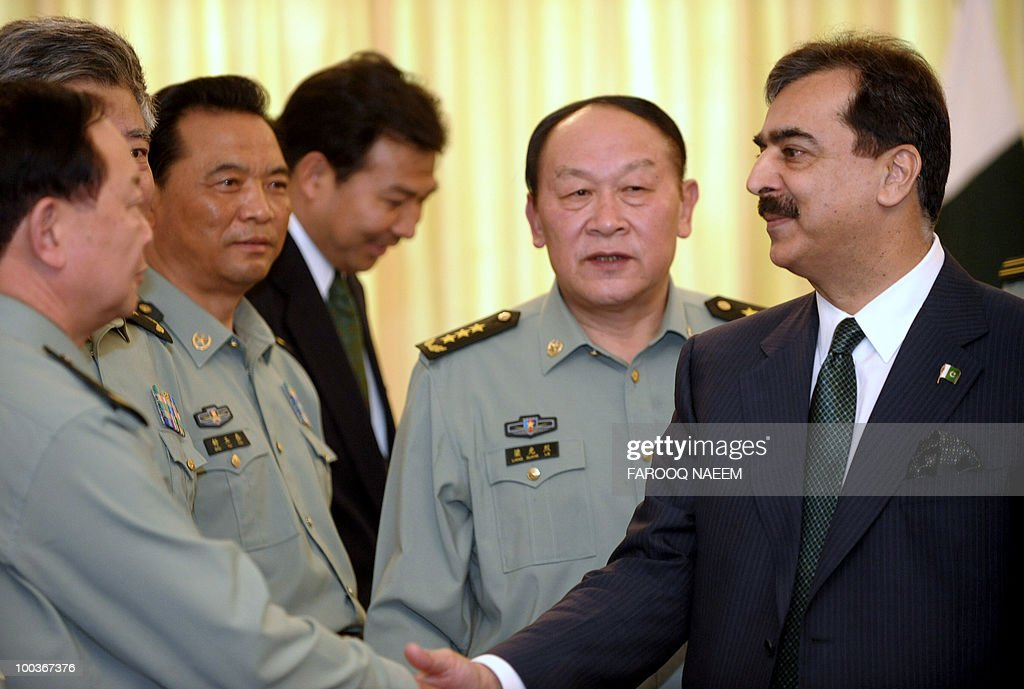 Chinese Defence Minister, General Liang Guangile (2R) introduces his delegation to Pakistani Prime Minister Yusuf Raza Gilani (R) upon arrival for a meeting in Islamabad on May 24, 2010. China agreed to provide four trainer aircraft for the Pakistan Air Force and 60 Million Yuan (8.8 million USD) for undertaking professional training of the Armed Forces of Pakistan. AFP PHOTO/Farooq NAEEM