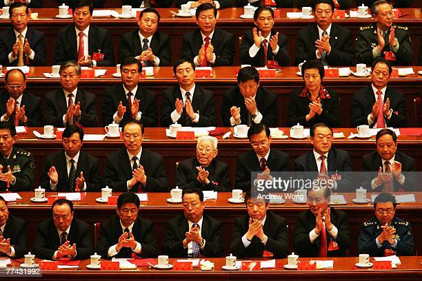 Chinese delegates applaud the result of a vote during the Chinese Communist Party Congress at the Great Hall of the People on October 21, 2007 in...