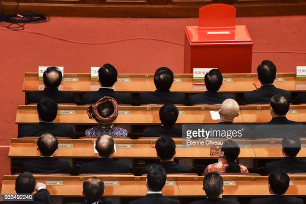 Chinese delegates attends the sixth plenary session of the National People's Congress at the Great Hall of the People on March 18 2018 in Beijing...