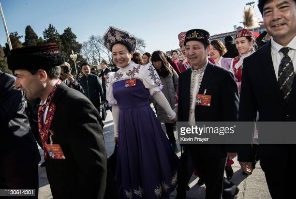 Chinese delegates from Xinjiang province arrive for the closing meeting of the National People's Congress on March 15 2019 in Beijing China The...