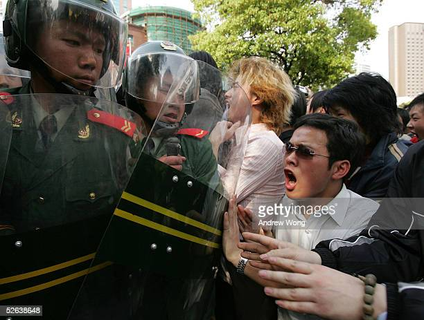 Chinese demonstrators clash with riot police outside the Japanese Consulate during an antiJapanese rally April 16 2005 in Shanghai China Protesters...