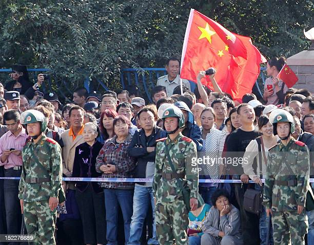 Chinese demonstrators gather outside the September 18 History Museum to protest against Japan's 'nationalizing' of the Diaoyu Islands also known as...