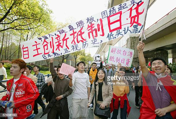 Chinese demonstrators holding a slogan calling for a boycott of Japanese products march during an antiJapanese rally on April 16 2005 in Shanghai...