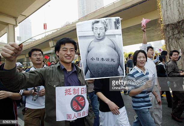 Chinese demonstrators holding defaced portrait of Japanese Prime Minister Junichiro Koizumi march during an antiJapanese rally on April 16 2005 in...