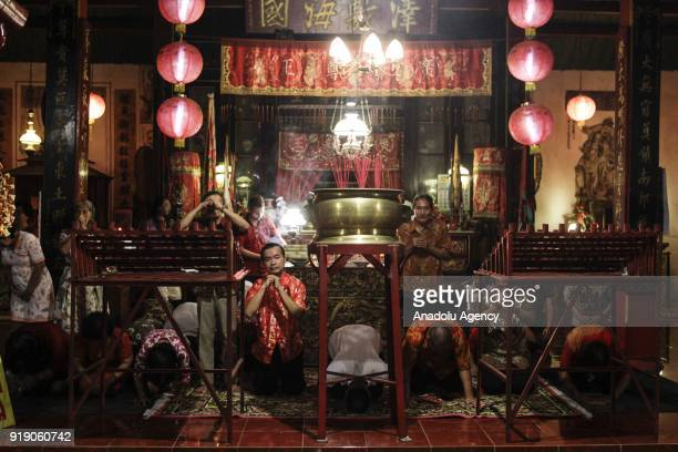 Chinese descendant pray in the Poo An Bio temple as a part of the Lunar New Year celebration in Lasem village of Rembang regency in Central Java...
