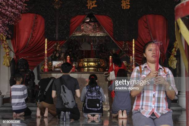Chinese descendants pray as a part of Lunar New Year celebration in the Sam Poo Kong temple in Semarang Central Java Indonesia on February 16 2018...