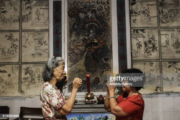 Chinese descendants pray in the Poo An Bio temple as a part of the Lunar New Year celebration in Lasem village of Rembang regency in Central Java...