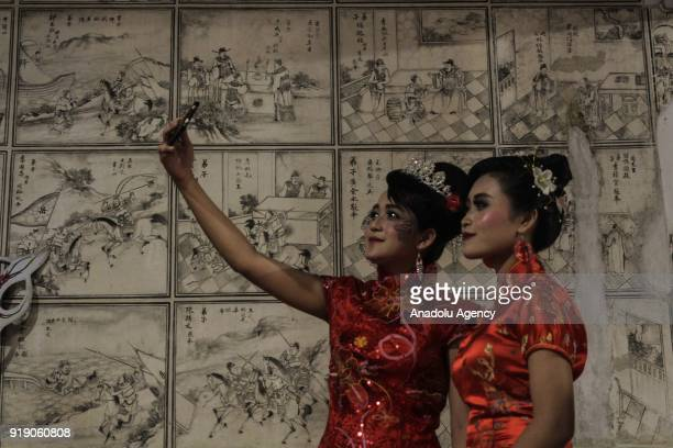 Chinese descendants take a selfie after praying in the Poo An Bio temple as a part of the Lunar New Year celebration in Lasem village of Rembang...