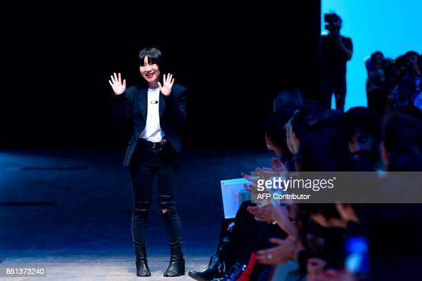 Chinese designer Anna Chang greets the audience at the end of the show Annakiki during the Women's Spring/Summer 2018 fashion shows in Milan on...