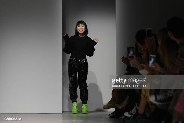 Chinese designer Anna Yang acknowledges applause following the presentation of the Annakiki Women's Spring/Summer 2019 fashion show in Milan on...