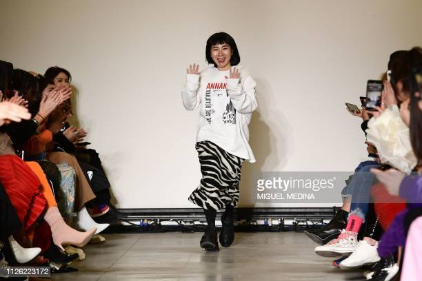 Chinese designer Anna Yang acknowledges applause following the presentation of the Annakiki women's Fall/Winter 2019/2020 fashion collection on...
