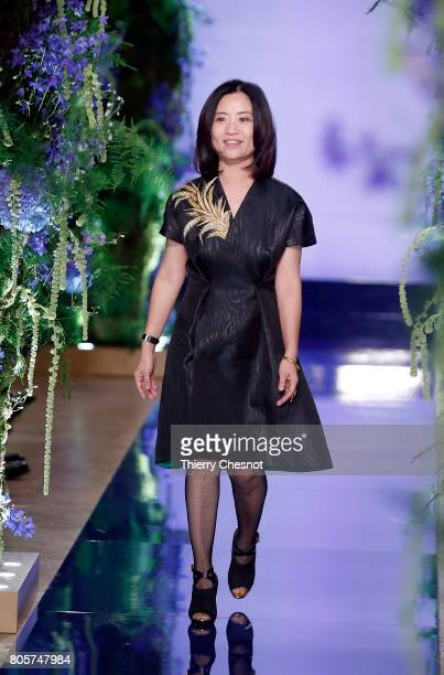 Chinese designer Guo Pei acknowledges the audience at the end of the Guo Pei Haute Couture Fall/Winter 2017-2018 show as part of Haute Couture Paris...