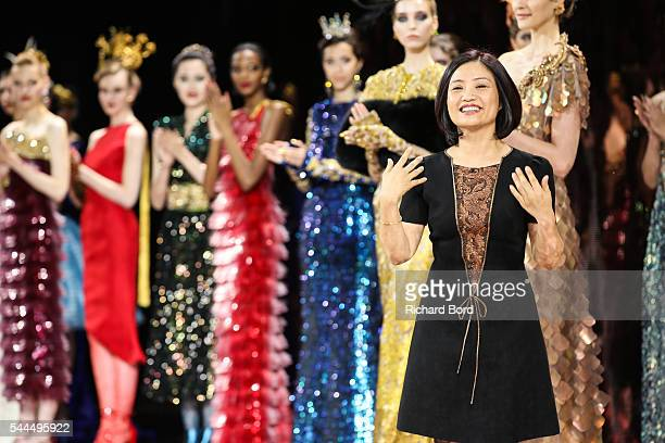 Chinese Designer Guo Pei walks the runway after the Guo Pei Haute Couture Fall/Winter 2016-2017 show as part of Paris Fashion Week on July 3, 2016 in...