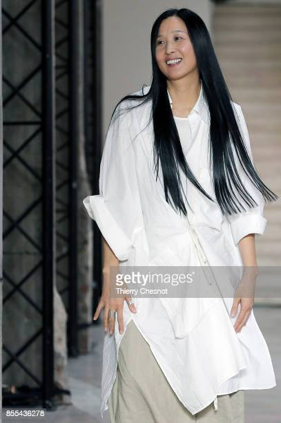 0a70614bd26 Chinese designer Uma Wang acknowledges the audience at the end of the Uma  Wang show as