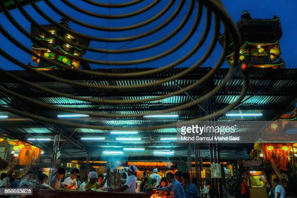 Chinese devotees perform a prayer during The Nine Emperor Gods Festival inside the temple on October 26 2017 in Kuala Lumpur Malaysia The Nine...