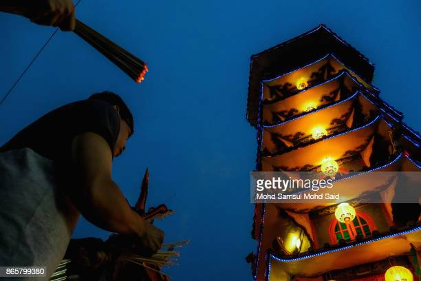 Chinese devotees perform prayer during the 5th day of The Nine Emperor Gods Festival inside the temple on October 24 2017 in Kuala Lumpur Malaysia...