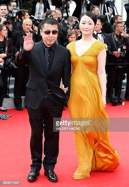 Chinese director and member of the Feature films Jury Jia Zhangke and his wife Chinese actress Zhao Tao pose as they arrive for the screening of the...