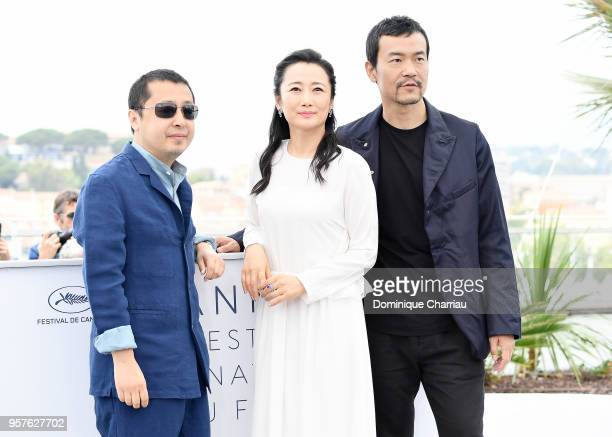 Chinese director Jia ZhangKe Chinese actress Zhao Tao and Chinese actor Liao Fan attend the photocall for the 'Ash Is The Purest White ' during the...