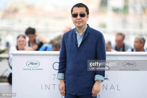 Chinese director Jia ZhangKe poses on May 12 2018 during a photocall for the film 'Ash is Purest White ' at the 71st edition of the Cannes Film...