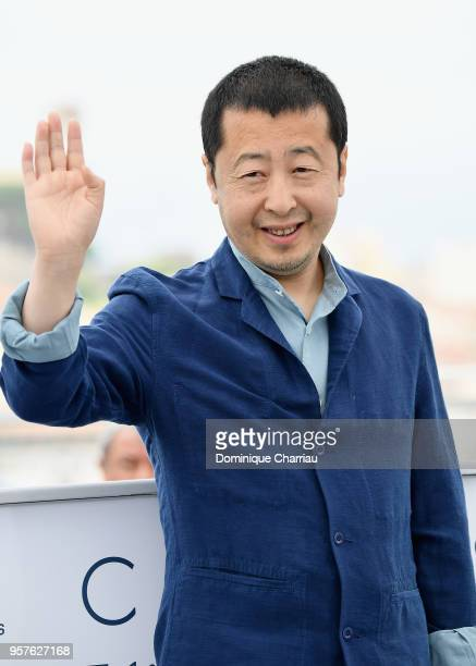 Chinese director Jia ZhangKe waves at the photocall for 'Ash Is The Purest White ' during the 71st annual Cannes Film Festival at Palais des...