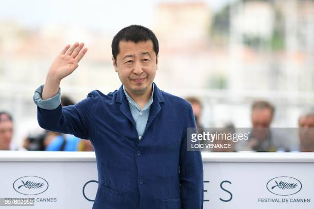 Chinese director Jia ZhangKe waves on May 12 2018 during a photocall for the film 'Ash is Purest White ' at the 71st edition of the Cannes Film...