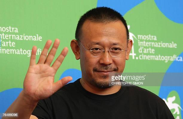 Chinese director Jiang Wen poses during a photocall of Taiyang Zhaochang Shengqi during the 64th Venice International Film Festival at Venice Lido 03...