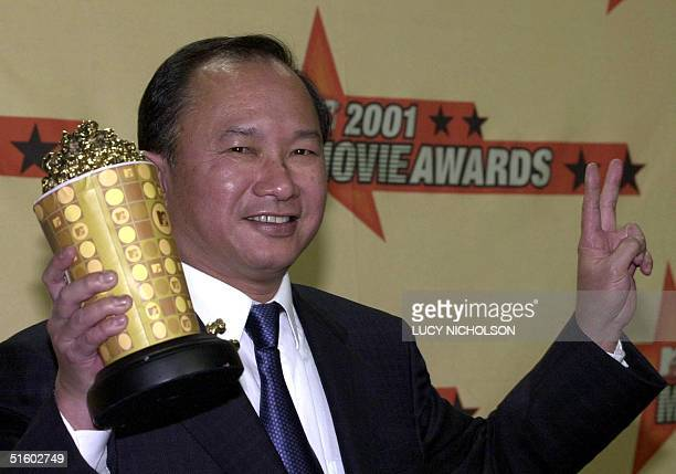 Chinese director John Woo shows off his award for best action sequence for his work in the film Mission Impossible II at the 2001 MTV Movie Awards at...