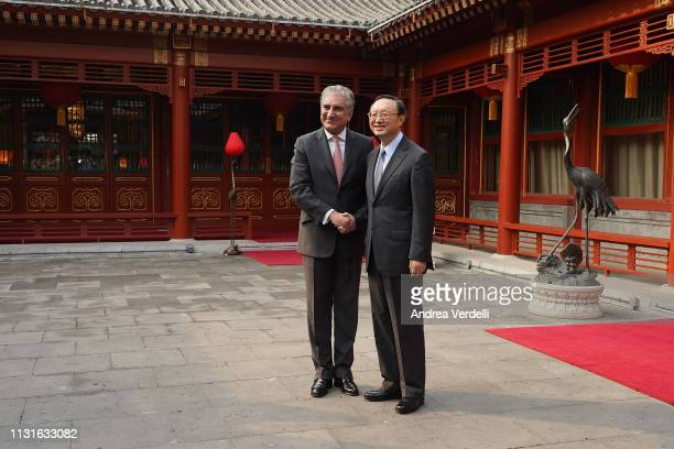 Chinese Director of the Central Foreign Affairs Commission Office Yang Jiechi shakes hands with Pakistani Foreign Minister Shah Mehmood Qureshi at...