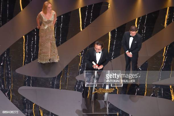 Chinese director Qiu Yang delivers a speech next to US actress and President of the Un Certain Regard jury Uma Thurman and Romanian director and...