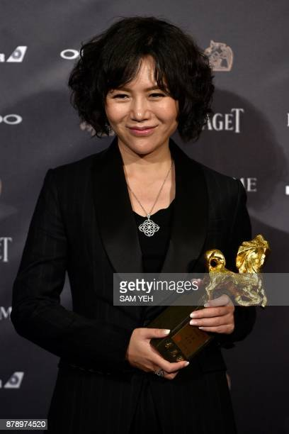 Chinese director Vivian Qu poses after winning the Best Director Award for her film 'Angels Wear White' at Taiwan's 54th Golden Horse film awards...