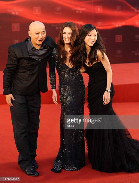 Chinese director Wang Anquan Spanish actress Paz Vege and Chinese actress Zhang Jingchu arrive at the red carpet of the 14th Shanghai International...