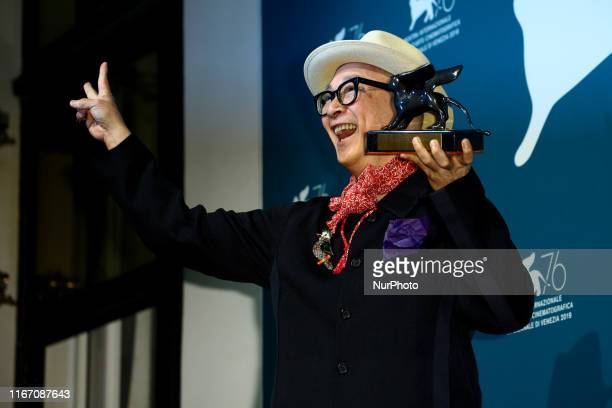 Chinese director Yonfan holds the Award for Best Screenplay he received for the movie quotNo7 Cherry Lanequot during the awards ceremony winners...